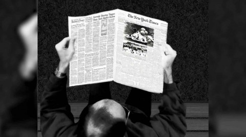 14_man_reading_newspaper